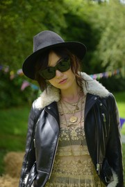 Daisy Lowe blinged up with a stylish gold charm necklace.