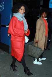 Yara Shahidi headed out in New York City wearing an Opening Ceremony coat in an eye-catching red hue.