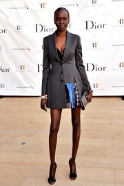 Alek Wek looked totally lovely and chic in this fitted gray coat dress that featured a full pleated skirt.