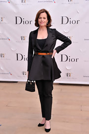 To keep her look sophisticated, Sigourney chose a pair of classic straight-leg slacks.