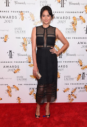 Emma Heming Willis made a stylish appearance at the Fragrance Foundation Awards in a sexy black mesh dress.