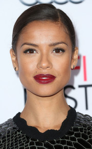 Gugu Mbatha-Raw highlighted her pout with a bold red hue for the Centerpiece Gala premiere of 'Concussion.'