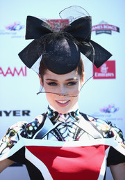 Coco Rocha was a head turner with her bow-adorned black Nerida Winter hat teamed with a chic Peter Pilotto dress during Melbourne Cup Day.