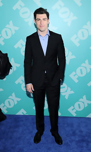 Max Greenfield chose a classic black suit for his sleek and streamline look at FOX's programming party.