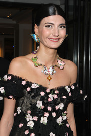 Giovanna Battaglia's butterfly necklace and earrings and flower-strewn dress at the Met Gala were a super-charming combination.
