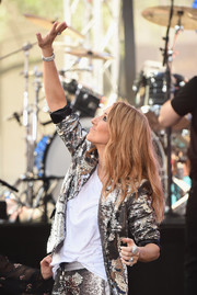 Celine Dion matched her silver suit with a dazzling diamond bracelet for her performance on the 'Today' show.