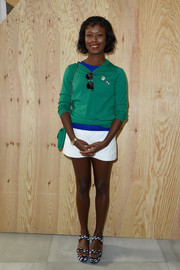 Shala Monroque completed her youthful outfit with a quilted white mini skirt.