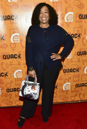Shonda Rhimes styled her look with a printed tote by Dior.