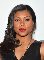 Taraji P. Henson's full lips looked even more envy-worthy with this bright red lip color.