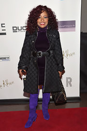 Chaka Khan sported knee-high, purple suede boots for a fun and unique look at her own birthday party.