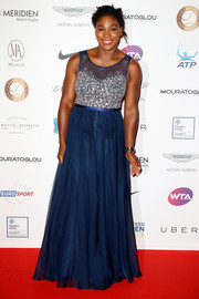 Serena Williams was in a princess-y mood at the Champ'Seed party, wearing this blue gown with a heavily beaded bodice.