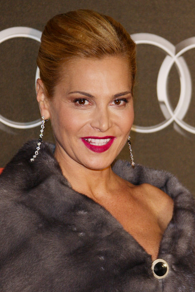 """Simona Ventura looked fun and glam at the same time with her dangling diamond earrings that spelled """"Amore."""""""