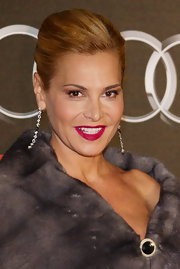 "Simona Ventura looked fun and glam at the same time with her dangling diamond earrings that spelled ""Amore."""