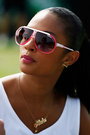 Alesha Dixon kept her eyes protected with a pair of designer shield sunglasses while watching the 2009 Wimbledon.