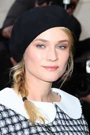 Diane Kruger went for a French schoolgirl look in a black beret.