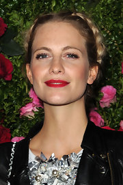 Poppy Delevingne topped off her look with bold red lips and rouged cheeks.