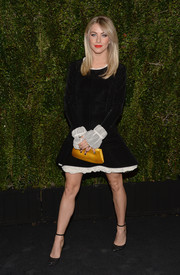 A yellow satin clutch added a little brightness to Julianne Hough's look.