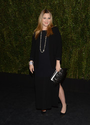 Drew Barrymore was in the mood for dark tones during her book release party, teaming a black Chanel blazer with a navy evening dress.