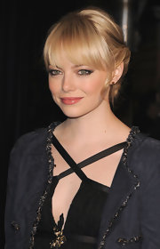 Actress Emma Stone attended the Chanel and Charles Finch Pre-Oscar Party wearing 18-karat gold spike stud earrings.