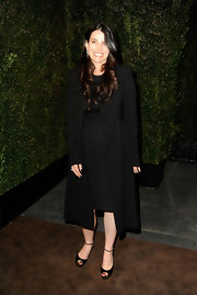 Julia accessorized with dark peep-toe pumps.