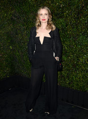 Julie Delpy layered a black tweed jacket over her jumpsuit for a smarter finish.