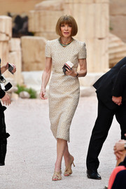 Anna Wintour looked impeccable in a beige tweed midi dress at the Chanel Cruise 2018 show.