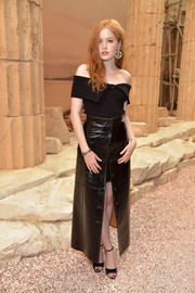 Ellie Bamber was trendy in a black off-the-shoulder top by Chanel during the label's Cruise 2018 show.