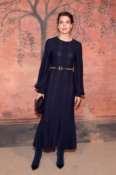 Charlotte Casiraghi looked impeccable at the Chanel Cruise photocall in an ankle-length navy dress with blouson sleeves and a pleated hem.