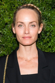 Amber Valletta kept it sweet with this crown braid at the Chanel dinner celebrating Lucia Pica.
