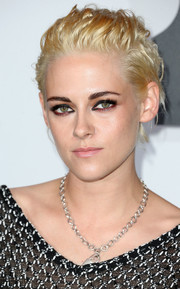 Kristen Stewart went ultra edgy with this messy cut at the Chanel dinner.