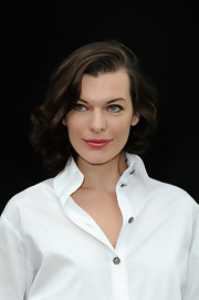 Light pink lips added a soft feminine touch to Milla Jovovich's classic look at the Chanel runway show.