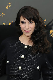 Caroline Sieber rocked long curls with choppy bangs at the Chanel runway show in Paris.