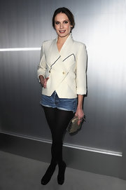 Ana Girardot dressed up her jean shorts with an ivory crepe blazer.