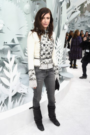 Anna Mouglalis went for a tough-chic finish with a pair of black mid-calf boots.