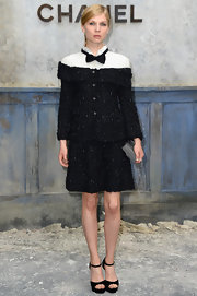 Clemence Poesy opted for classic elegance at the front row of Chanel Haute Couture where she wore this black tweed skirt suit that looked totally tuxedo-inspired.