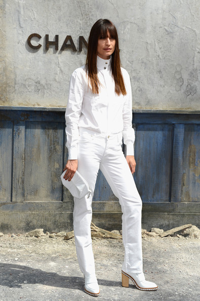 Caroline looked super sleek in crisp white jeans and a button down.
