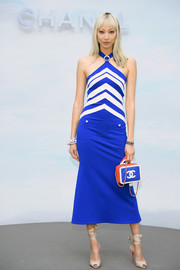 Soo Joo Park complemented her dress with a blue and red quilted purse by Chanel.