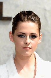 Kristen kept her look at the Chanel Haute Couture show as sleek as possible by opting for a shellacked ponytail.