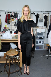 Lauren Santo Domingo got all prettied up in this black ruffle blouse for the Chanel Couture show.