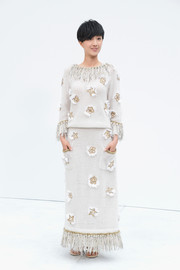 Kwai Lun-mei charmed in an appliqued gray Chanel maxi dress with fringe detailing during the label's fashion show.