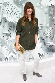 Caroline De Maigret chose a pair of white skinny pants to team with her shirt.