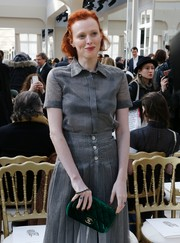 Karen Elson kept it conservative in a short-sleeve gray button-down and a matching pleated skirt at the Chanel fashion show.