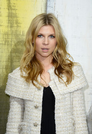 Clemence Poesy wore her hair in sexy waves at the Chanel fashion show.