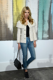 Clemence Poesy contrasted her elegant jacket with casual high-waist jeans when she attended the Chanel fashion show.