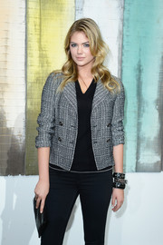 Kate Upton went for casual elegance with a tweed jacket layered over a V-neck shirt during the Chanel fashion show.