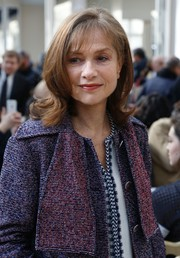 Isabelle Huppert wore her hair in a cute flip when she attended the Chanel fashion show.