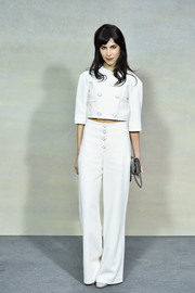 Caroline Sieber opted for a white pantsuit, featuring a cropped top and high-waisted pants, for the Chanel fashion show.