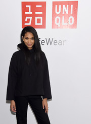 Chanel Iman stayed comfy in a black hoodie while attending a Uniqlo press event.
