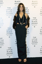 Carine Roitfeld paired her crop-top with a long black skirt for a more elegant finish.