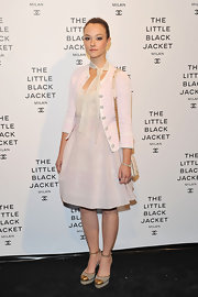 Marta Gastini paired this light pink blazer over her soft pink frock for an even more feminine look at the Chanel 'The Little Black Jacket' event in Milan.
